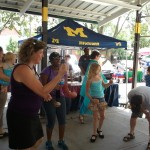 About eight people start juggling in the aisles at the Mity Nice Street Fair.