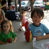 Two boys made puppets at the Mity Nice Arts & Crafts table. At right, Asteroid with his elaborate creature.